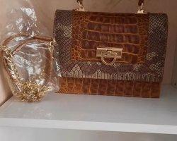 کیف چرم در حراجی و فروشگاه اینترنتی